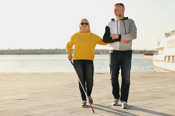 Couple walking on the boardwalk.