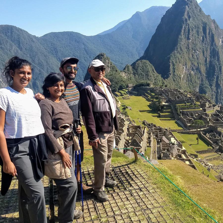 Photo of Vani Nilakantan and three adults.